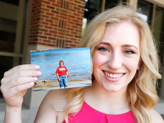 Kirsten Johnson shows a photograph of her late mother,