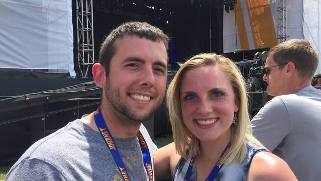x and Jessica Rowley wait for Journey's performance from the front row at the Carb Day Stage.
