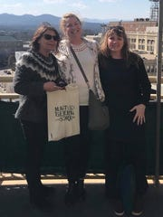 Pascale Berg, Jennifer Caldwell and Tine Andreasen stop for a photo while visiting downtown Asheville, Mar. 15.