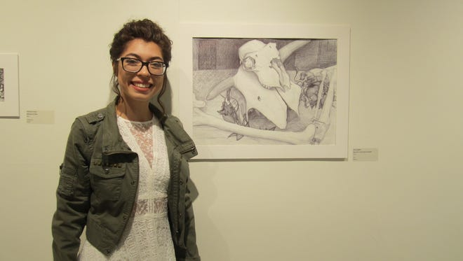"Kiana Ziegler of Ahsland received he Bernini Award  for her mixed media work titled ""Amor."""