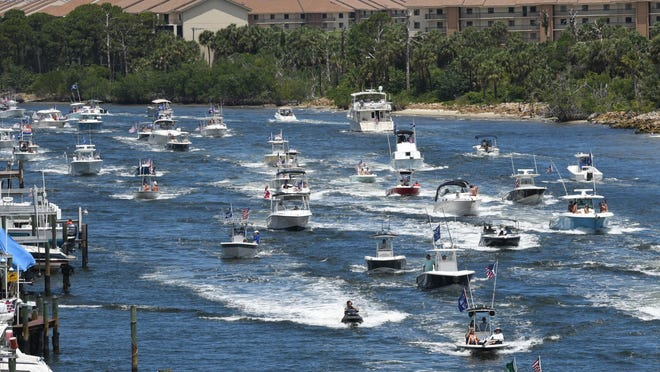 Hundreds of Trump supporters take to the Intracoastal Waterway in a show of support during a boat parade from Jupiter to Mar-a-Lago in Palm Beach. Sunday, May 3, 2020 in West Palm Beach.