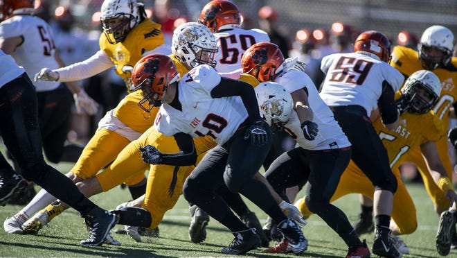 Players scramble from Pueblo East and Erie battle in the playoffs on Nov. 24, 2018, at Dutch Clark Stadium.