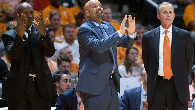 Assistant coaches Rob Lanier, center, and Desmond Oliver have been with head coach Rick Barnes, right, since he came to Tennessee in April 2015.