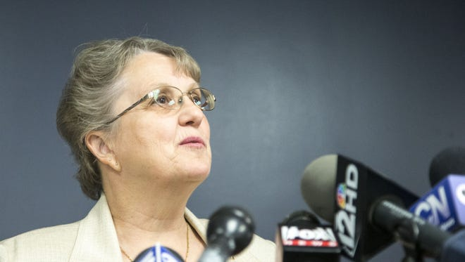 Superintendent Diane Douglas talks to media at the State department of Education building on Feb. 13, 2015. The state's schools chief abruptly fired the top two administrators for the state Board of Education Wednesday, with some education leaders questioning whether the firings were politically motivated or legal.