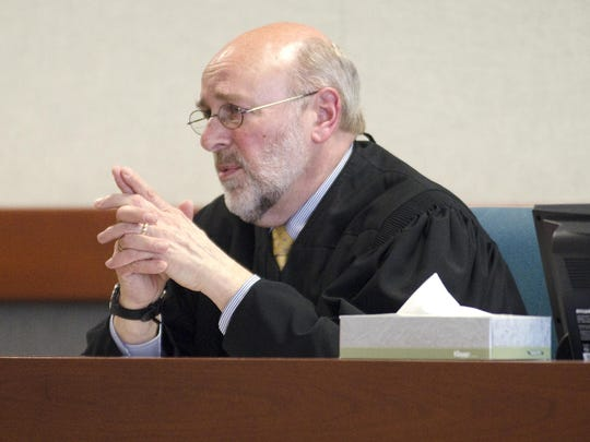Judge Brian Grearson is seen in Vermont Superior Court in Burlington in March 2012.