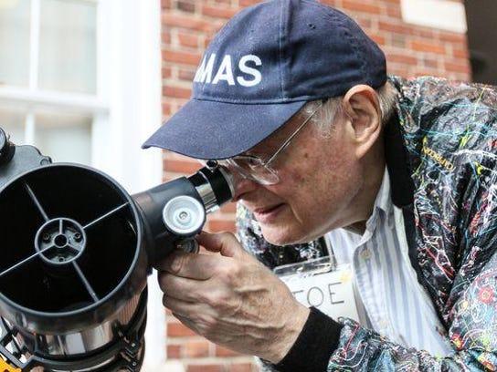 Astronomer Joe Molnar telescope