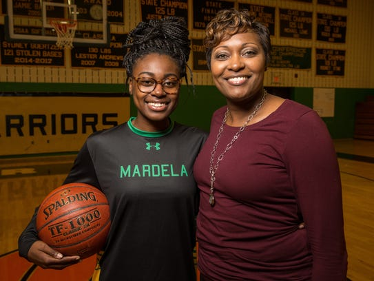 Kayla Cook, a senior guard at Mardela high school, poses for a photo with her mother, Mardela girls basketball coach Kesha Cook, on Thursday, Dec. 14.