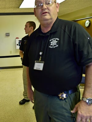 Sheriff James Brown, front, with Deputy Spencer Taylor during a break between visitors Monday, September 12, 2016 at the Franklin County Courthouse. County buildings are changing the way they secure the facilities.