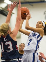 Cedar Crest's Ariel Jones drives to the hoop for two of her game-high 20 points against Lebanon's Lucy Yorty.