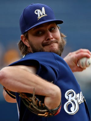 Milwaukee Brewers starting pitcher Wade Miley delivers in the first inning of a baseball game against the Pittsburgh Pirates in Pittsburgh, Sunday, Sept. 23, 2018. (AP Photo/Gene J. Puskar)