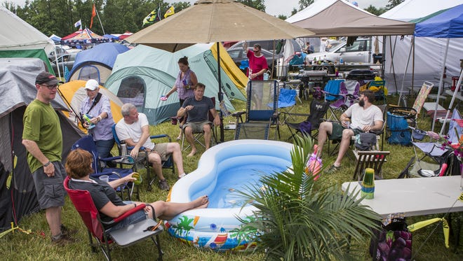 Campers attending their fourth straight Firefly Festival gather around an inflatable pool in their compound of 10 campsites in The Clearing campground at Firefly on Thursday afternoon.