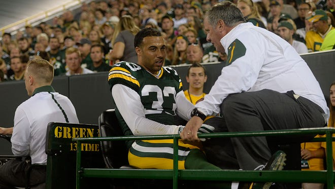Green Bay Packers' Micah Hyde leaves the game after getting injured during Saturday night's preseason game against the Philadelphia Eagles at Lambeau Field.