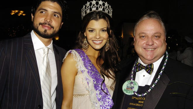 Alejandro Monteverd, from left to right, former Miss U.S.A. Ali Landry and Dee Stanley attend the Twelfth Night Celebrity Waiter Gala on Saturday night at River Oaks Catering in Lafayette.