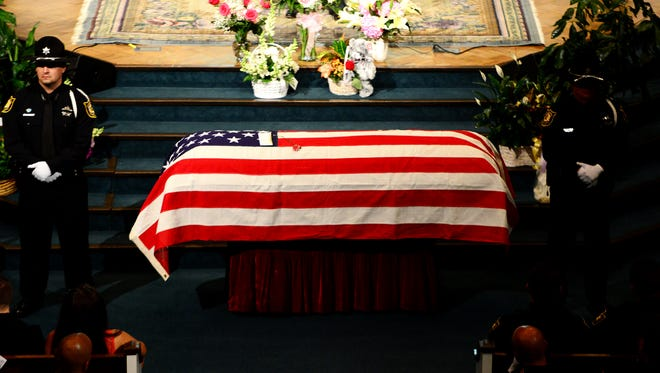 The US Honor Flag drapes the coffin of fallen Madison County Sheriff's Deputy Rosemary Vela during her funeral, Friday, October 2, 2015 at West Jackson Baptist Church.