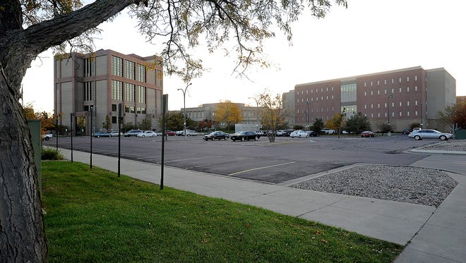The jail expansion will go in the parking lot south of Fourth Street between Minnesota and Main Avenue in Sioux Falls, SD; Monday, Oct. 19, 2015.