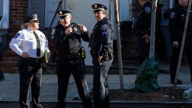 Wilmington police officers investigate the scene of a shooting in the 900 block of Maryland Ave. on Tuesday afternoon.