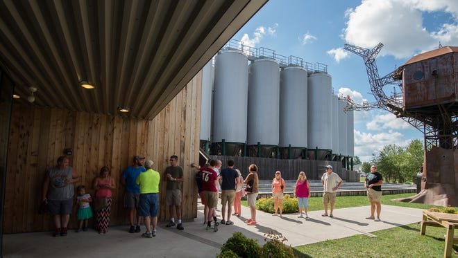 Visitors to Dogfish Head Brewery in Milton wait in line for them to open for tours and tastings.