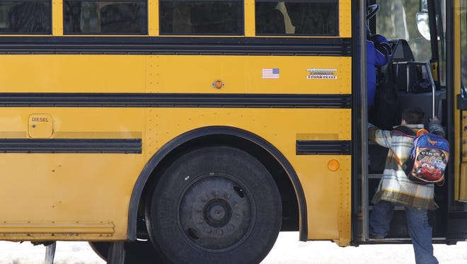 Students at Spring Mill Elementary School in Washington Township board the bus to go home, February, 2009. Investigators say the boy was dropped off by bus #42 and then he darted between 2 parked cars, crossing in front of bus #97 when he was struck by #97 and killed at the scene. (Sam Riche / The Indianapolis Star) <b>02/11/2009 - A15 - MAIN - 2ND - THE INDIANAPOLIS STAR</b><br />Re-evaluating: Students at Spring Mill Elementary School get on buses for the ride home. Washington Township Schools officials are rethinking the process for loading and unloading students in light of a fatal bus accident Friday.