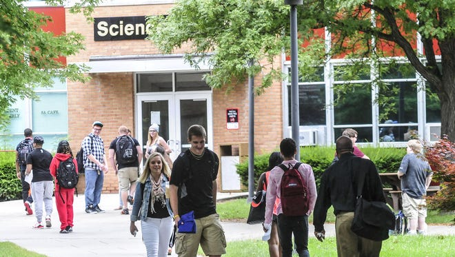 Students walk on SUNY Broome's campus.