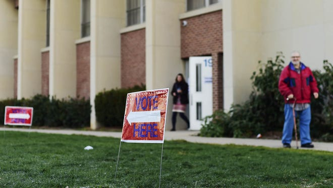 Voters leave Alexander D. Goode School after voting before 7:30 a.m. in York Tuesday.