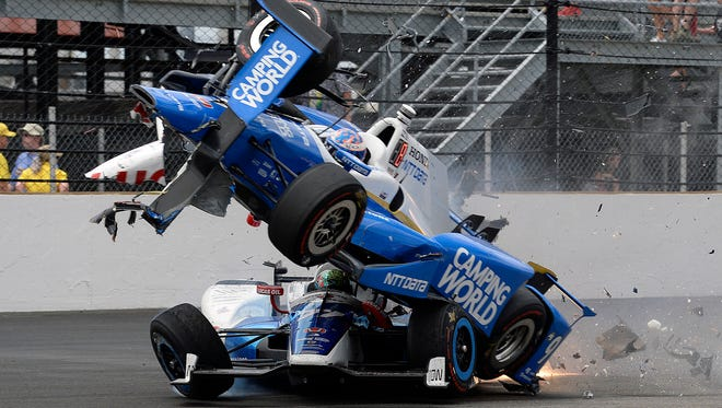 Scott Dixon goes over the top of Jay Howard in the first turn on the 53rd lap of the Indianapolis 500.