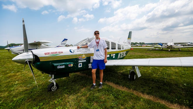 Mason Andrews of Monroe, Louisiana, stands next to his PA-32 Lance plane Monday, July 23, 2018, at EAA AirVenture in Oshkosh. Andrews is trying to become the youngest pilot to circumnavigate the earth at age 18. He started his trip July 22 and hopes to finish by Sept. 25.
