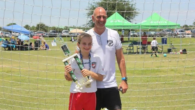 Tim Michaud knew nothing about soccer, but began coaching four years ago because of his daughter, Riley.