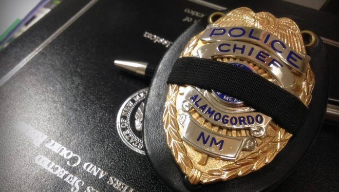 Law Enforcement Officers at the Alamogordo Police Department and the Otero County Sheriff's Department wear mourning bands on their badges to honor the five police officers who were killed in Dallas on Thursday night.