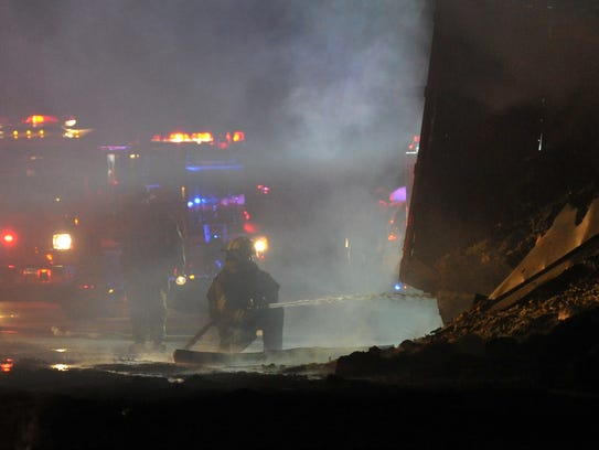 Iowa Park firefighters work to extinguish a fiery fatal