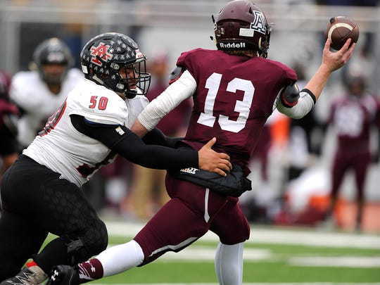 Anson defensive lineman Brandon Padilla (50) hits Abernathy quarterback Bryson Daily (13) during the third quarter of Anson's 21-18 loss in the Class 2A Div. I state quarterfinal playoff on Saturday, Dec. 3, 2016, at Tiger Stadium in Snyder.