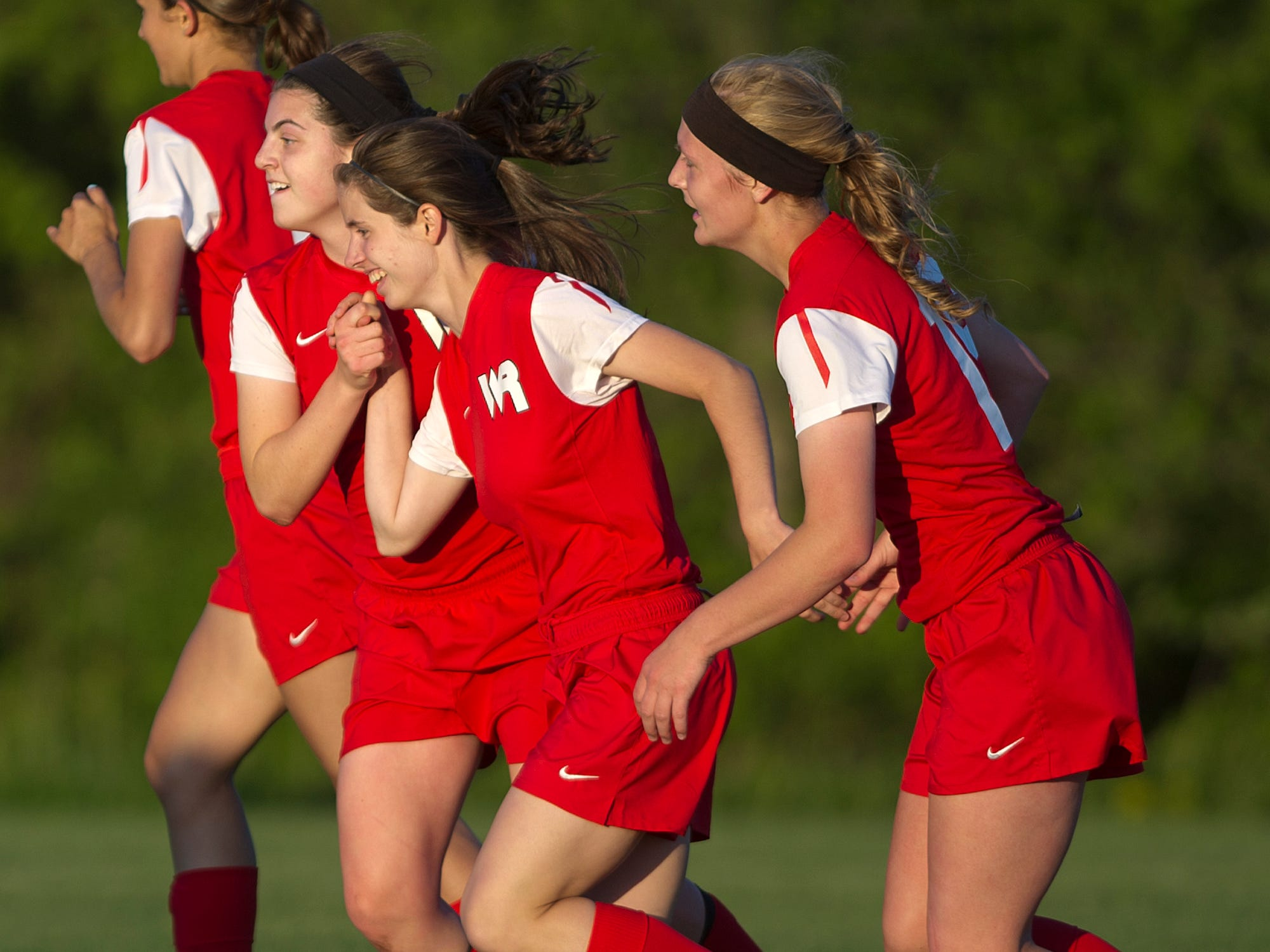 Wisconsin Rapids' Katy Schooley, center, celebrates her goal in the first half with her teammates Thursday during the Wisconsin Valley Conference soccer game against Stevens Point Area Senior High at the Portage County Youth Soccer Complex in Stevens Point.