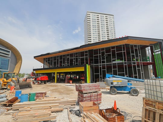 A Punch Bowl Social restaurant will open in the Milwaukee Bucks entertainment block under construction in July outside the new Milwaukee Bucks arena.