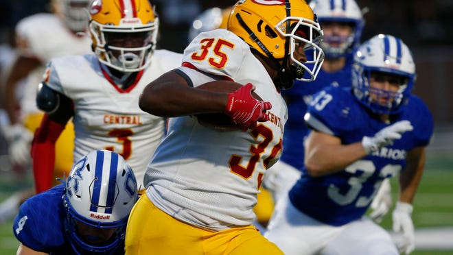 Clarke Central's William Richardson (35) avoids a tackle from Oconee County's Whit Weeks (4) during an GHSA high school football between Oconee County and Clarke Central in Watkinsville, Ga., on Friday, Sept. 18, 2020. Oconee County won 24-7.