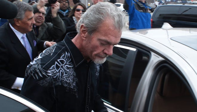 Indianapolis Colts owner Jim Irsay exits a Noblesville detention facility on the day after he was arrested on four felony counts in Carmel, Ind.