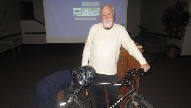 The Rev. Bob Cook and his battery-powered Giant mountain bike, which he tries to ride around Des Moines whenever possible.