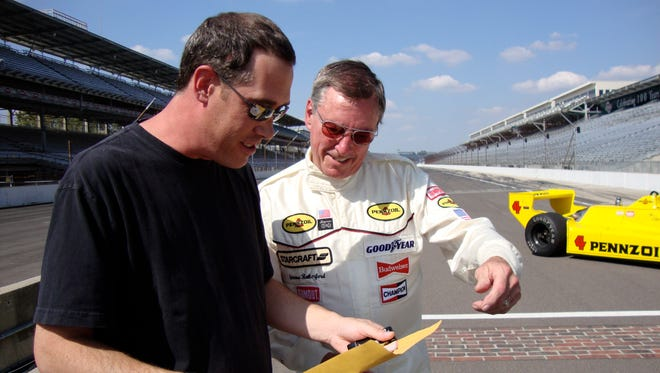 John Oreovicz, a 1982 West Lafayette graduate, interviews three-time Indianapolis 500 champion Johnny Rutherford in 2009 after Rutherford turned some demonstration laps in his 1980 race winner.