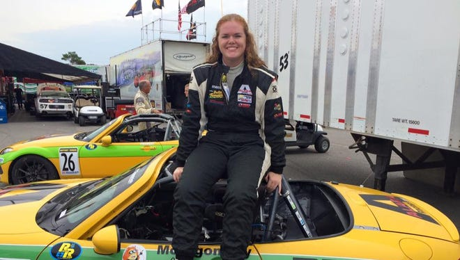 """Lafayette's Sarah Montgomery, shown here sitting on her """"Lemons of Love' Mazda car, finished in the top 10 of this year's MX-5 Cup Series."""