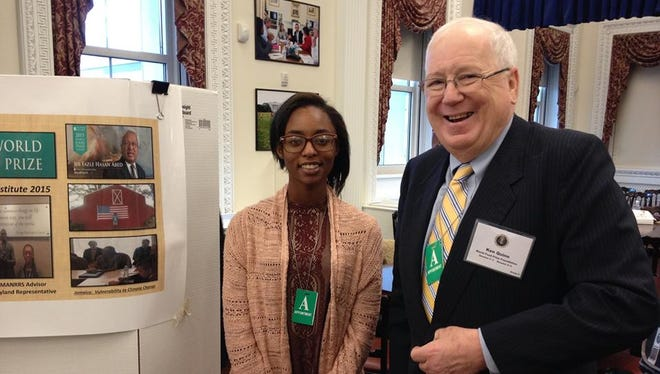 Gabrielle Morris (left) stands with Dr. Kenneth Quinn, former ambassador and president of world food prize. Morris participated earlier this week at a White House summit and exhibition that presented student research on agricultural programs designed to raise awareness of issues facing the industry and underscore the value of best practices.