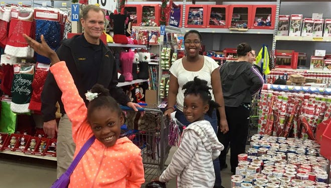 Clarksville Police Chief Al Ansley shops with the kids and families Saturday during Shop With a Cop