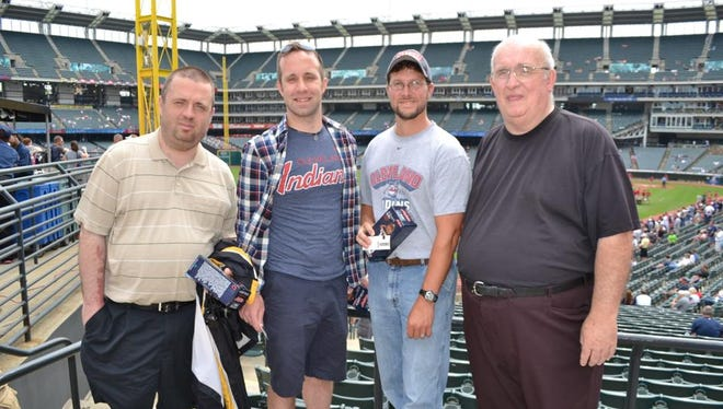 From left, columnist Chris Pugh, his brother, his brother-in-law and his Dad attend a Cleveland Indians game at Progressive Field.