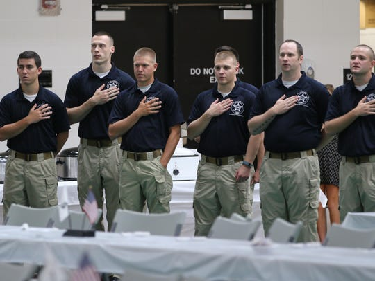 Cadets say the Pledge of Allegiance on Saturday at