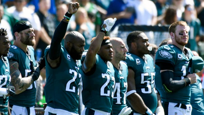 Philadelphia Eagles strong safety Malcolm Jenkins (27) and free safety Rodney McLeod (23) raise a fist in the air during the national anthem before the kickoff of their game against the Los Angeles Chargers at StubHub Center.