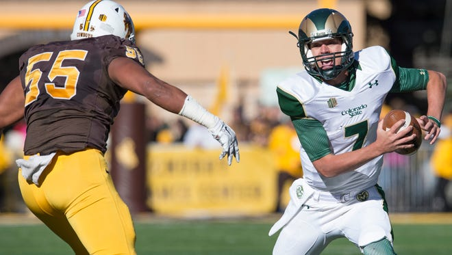 CSU quarterback Nick Stevens scrambles with the ball during a game at Wyoming in 2015. Stevens comes in at No. 2 on our list of most important Rams for 2016.