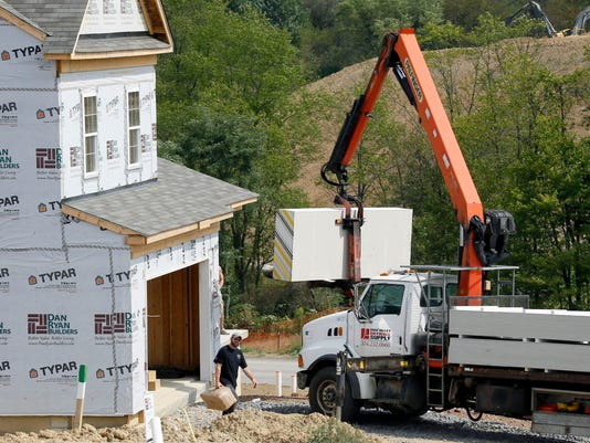 Aug. housing starts fall 14% after July surge