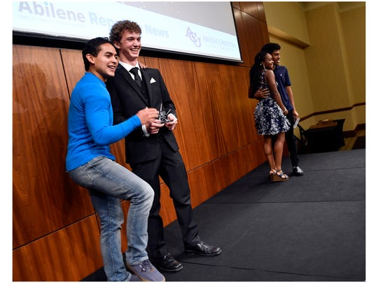 Star Student Noah West poses for a picture with his church youth leader Danny Zipprich (in blue) after Tuesday's Star Student Awards banquet at Abilene Christian University June 19, 2018.