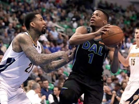 Denver Nuggets forward Wilson Chandler (21) defends as Dallas Mavericks guard Dennis Smith Jr. (1) looks for a shot during the second half of an NBA basketball game in Dallas, Tuesday, March 6, 2018. (AP Photo/Tony Gutierrez)