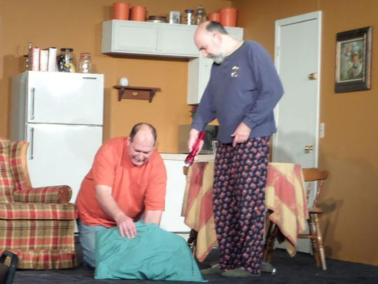 """From left, Chuck Goddeeris, Royal Oak; Dave Durham, Garden City and Eric Goldstein of Southfield capture a rat on the loose in a scene from Rosedale Community Players production of """"The Boys Next Door."""""""