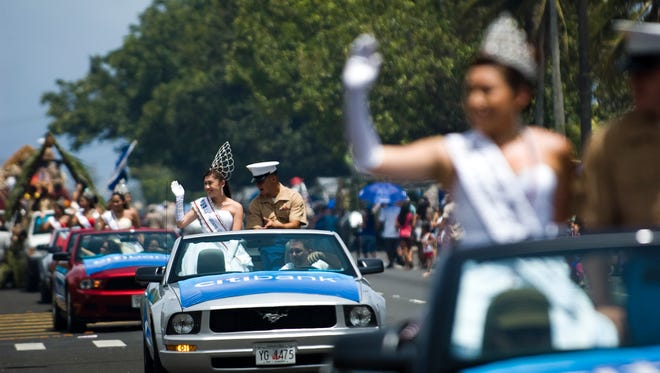2010 CNMI Liberation Queen Peachy Quitugua waves to the crowd during the 2010 Liberation Day parade.