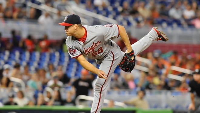 Jonathan Papelbon earned his first save with the Nationals.