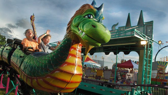 Savanna Felts, 5, left, and cousin Alli Long, 7, of Portland enjoy the dragon ride at the Sumner County Fair last year. The annual event kicks off June 27 and ends July 2.